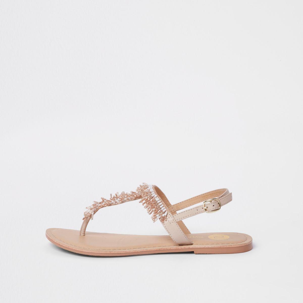 Lichtroze geborduurde sandalen met kraaltjes