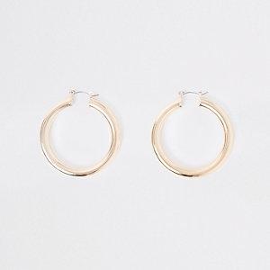 Gold tone chunky round hoop earrings