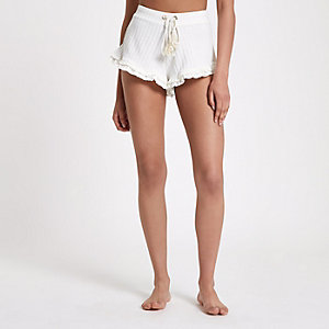 Cream frill hem ribbed pajama shorts