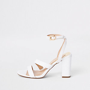 White asymmetric strappy block heel sandals