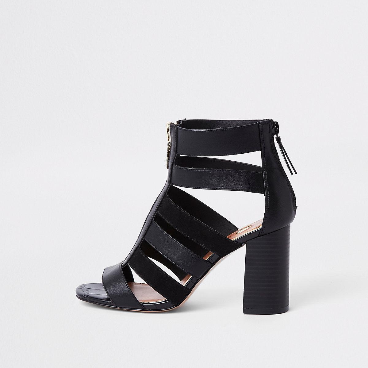 Black caged block heel shoe boots