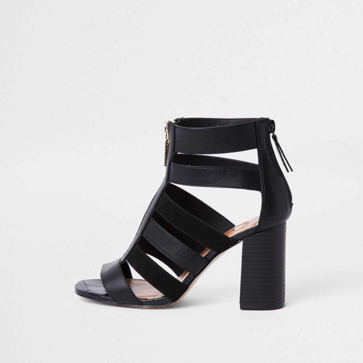 Black caged block heel shoe boots