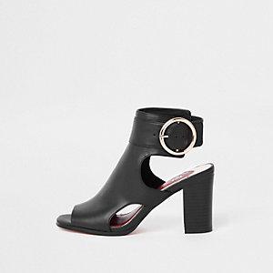 Black sling back oversized buckle shoe boots