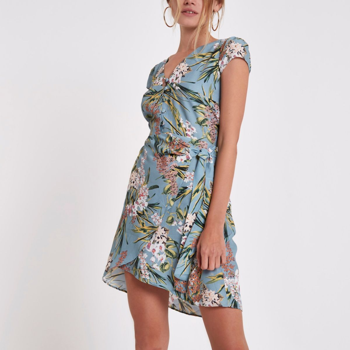 Blauwe mini-jurk met overslag, bloemenprint en knoopsluiting voor