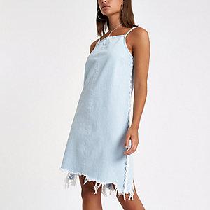 Lichtblauwe denim jurk met bies opzij
