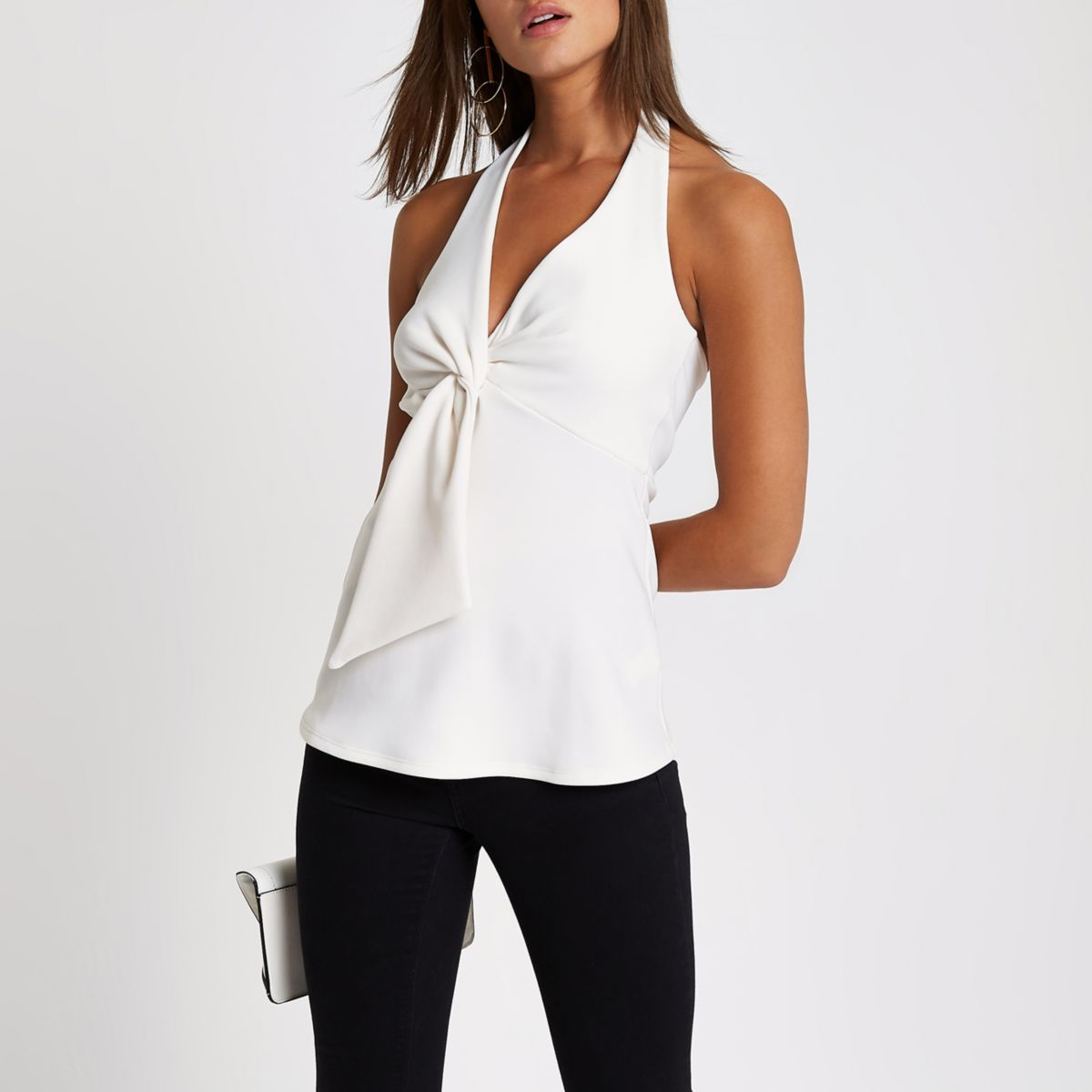 White peplum hem halter neck top