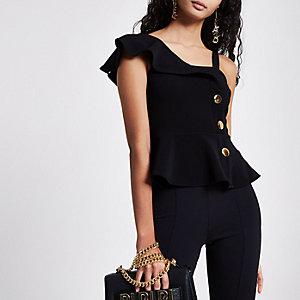Zwarte top met peplum, knoopsluiting en blote schouder