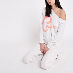 Witte top met blote schouder en 'couture'-print
