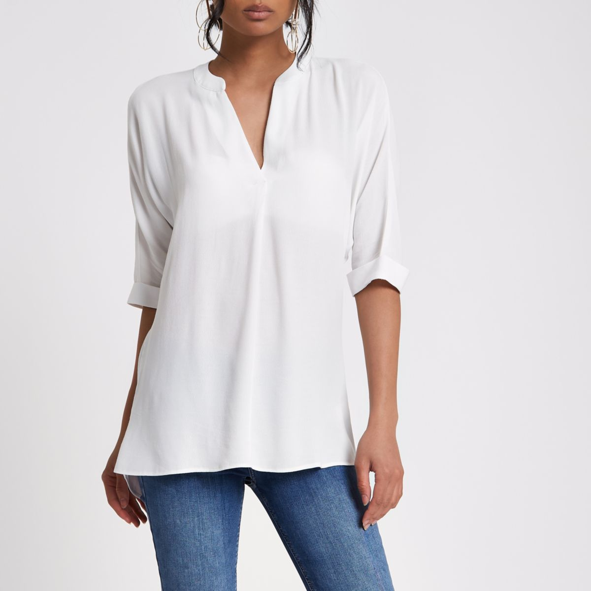 White short sleeve twist back blouse