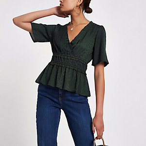 Green shirred waist short sleeve top