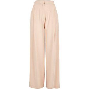 Pantalon large rose clair à bandes motif tourbillons
