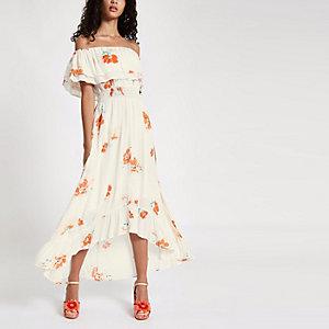 Crème maxi-jurk met bloemenprint en ongelijke zoom