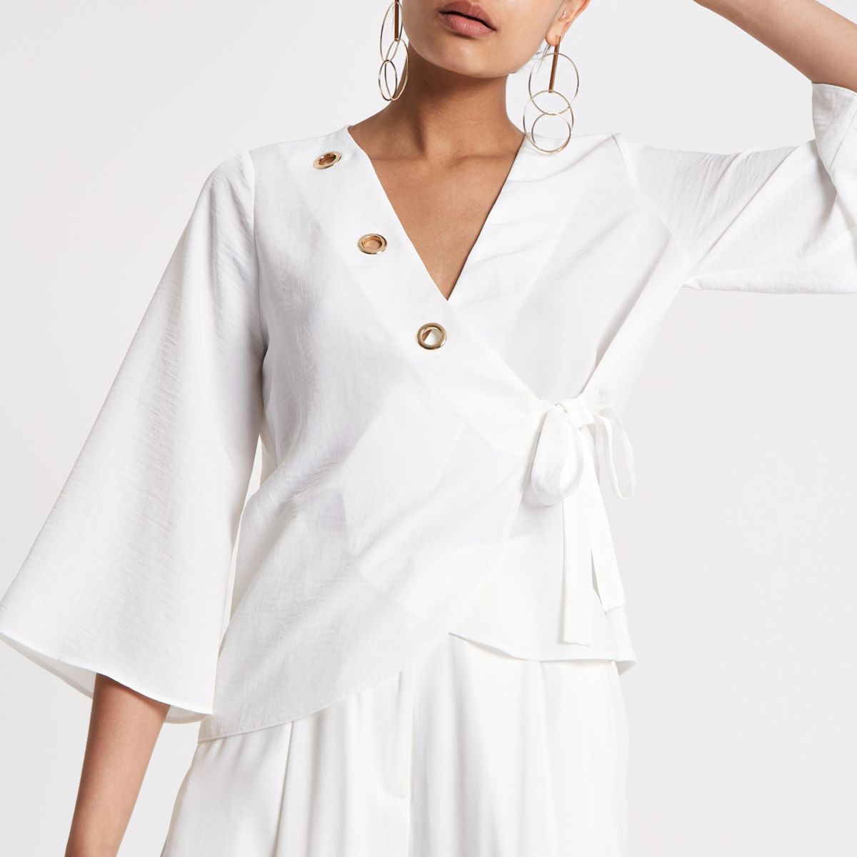 White eyelet tie waist wrap top