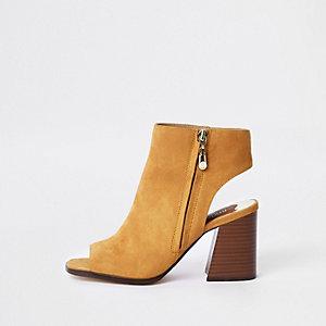 Gele schoenlaarsjes met rits opzij en brede pasvorm