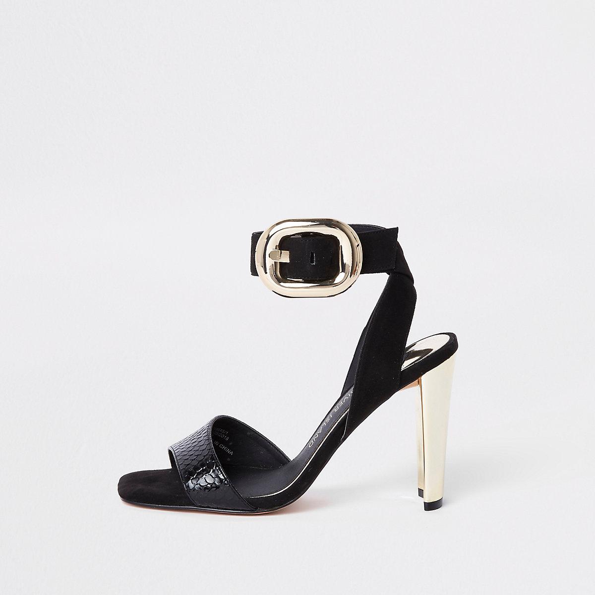 Sandales noires à boucle dorée coupe large
