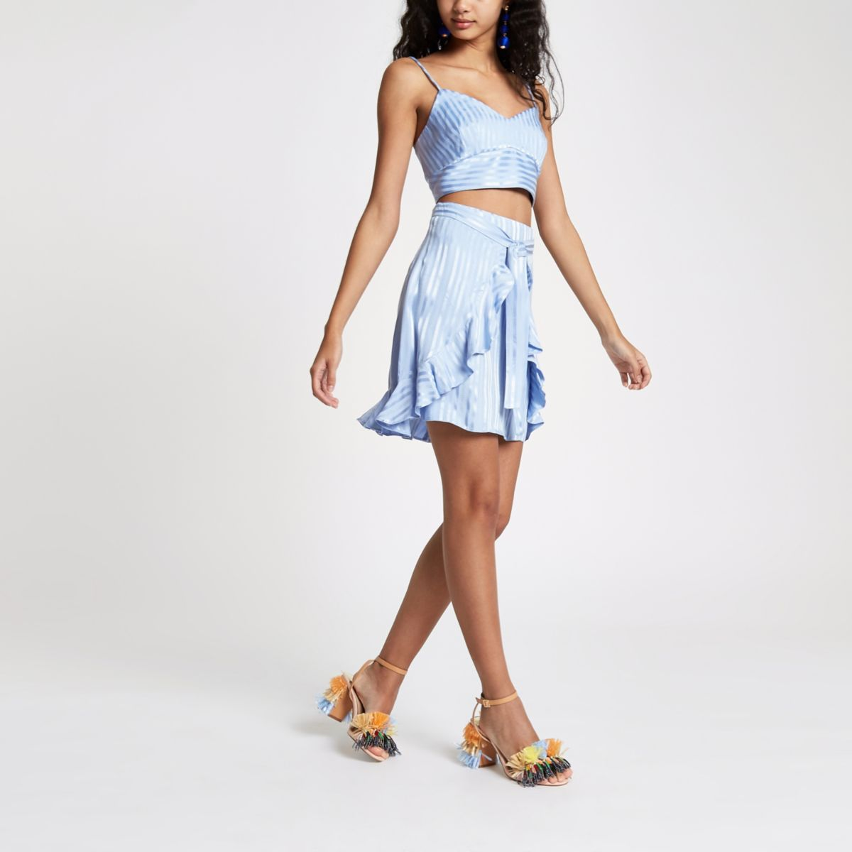 Mini-jupe façon portefeuille rayée bleue nouée devant