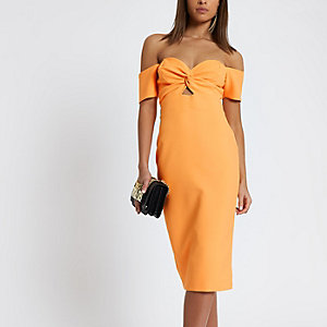 Robe Bardot mi-longue moulante orange avec nœud