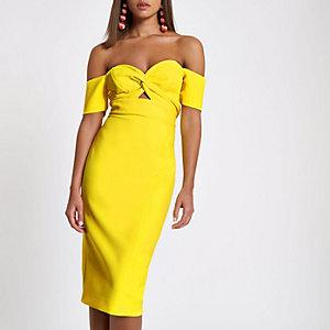 Robe moulante Bardot jaune nouée sur le devant