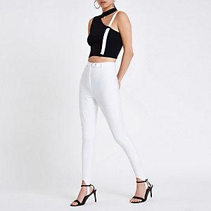 Witte legging met voetbandjes en hoge taille