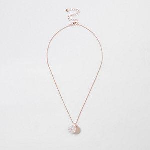 Collier or rose à pièces et perles à facettes