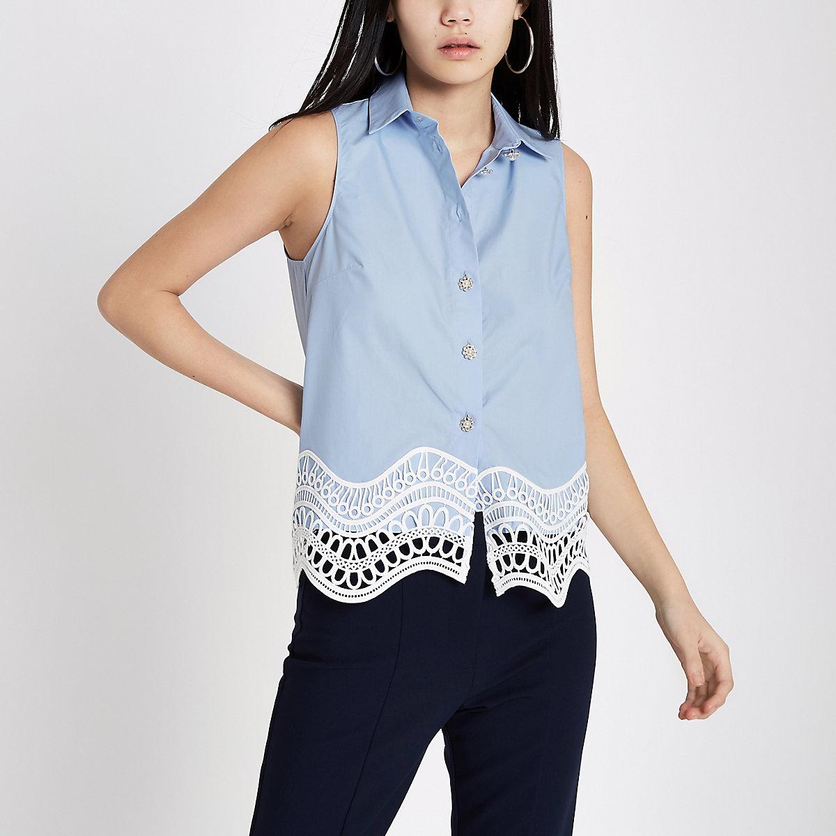 Blauw mouwloos overhemd met kanten zoom