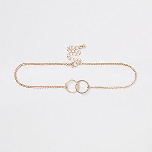 Collier ras-de-cou doré à anneaux entrelacés avec chaîne