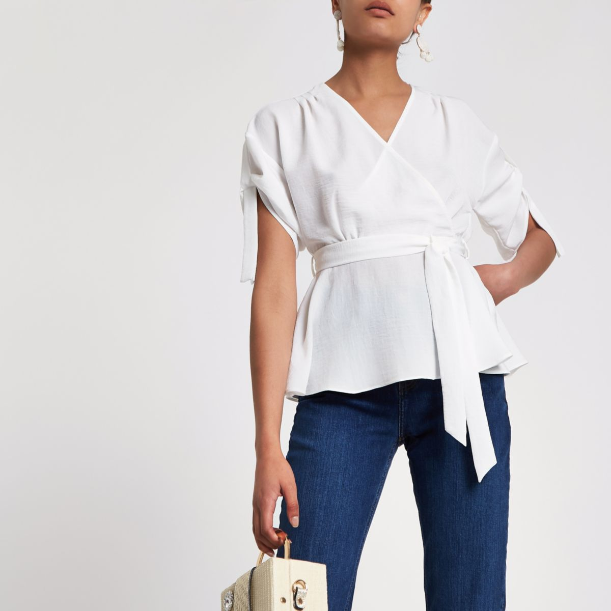 Cream wrap side ruched sleeve top