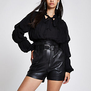 Black puff sleeve tie neck crop top