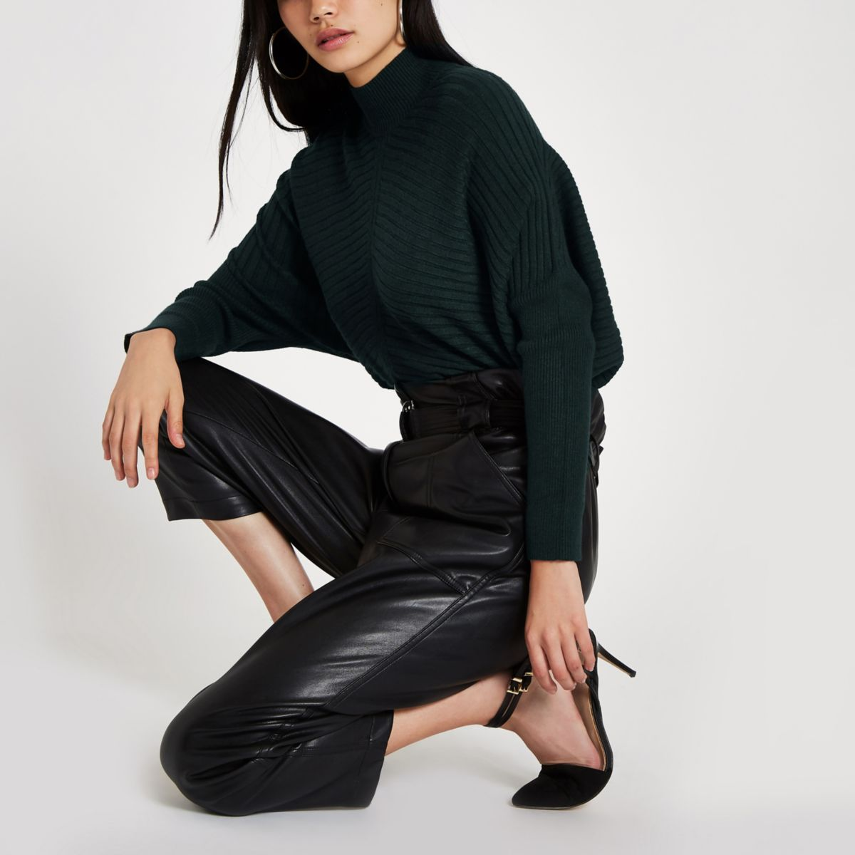 Dark green ribbed knit high neck sweater