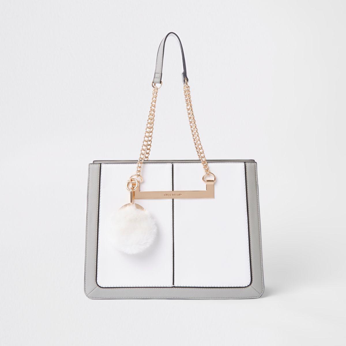 White chain handle pom pom tote bag