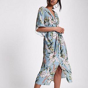 Blauwe jurk met gedraaide voorkant en bloemenprint