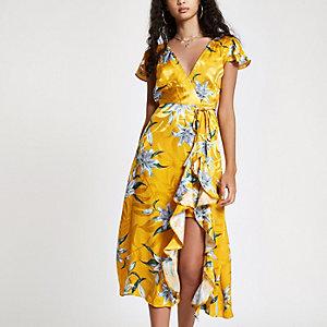 Gele maxi-jurk met bloemenprint, ruches en split in de zoom
