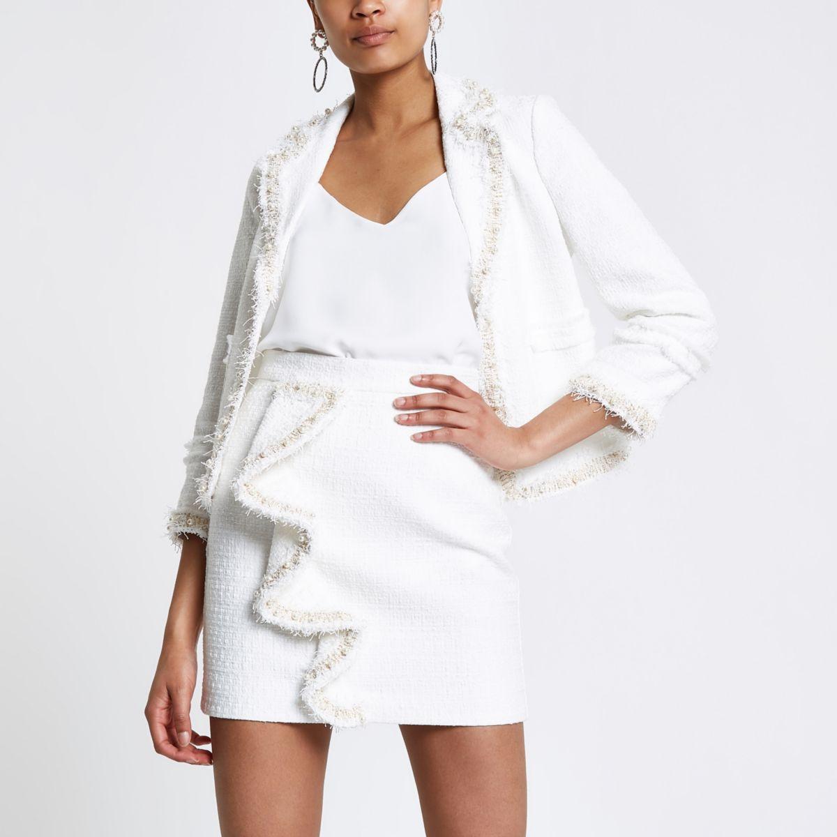 White boucle frill pearl mini skirt