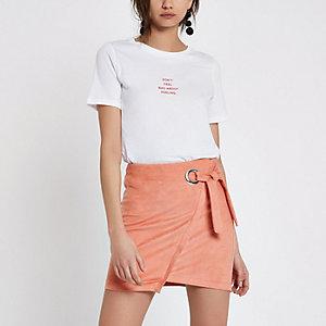 Pink wrap eyelet tie-up mini skirt