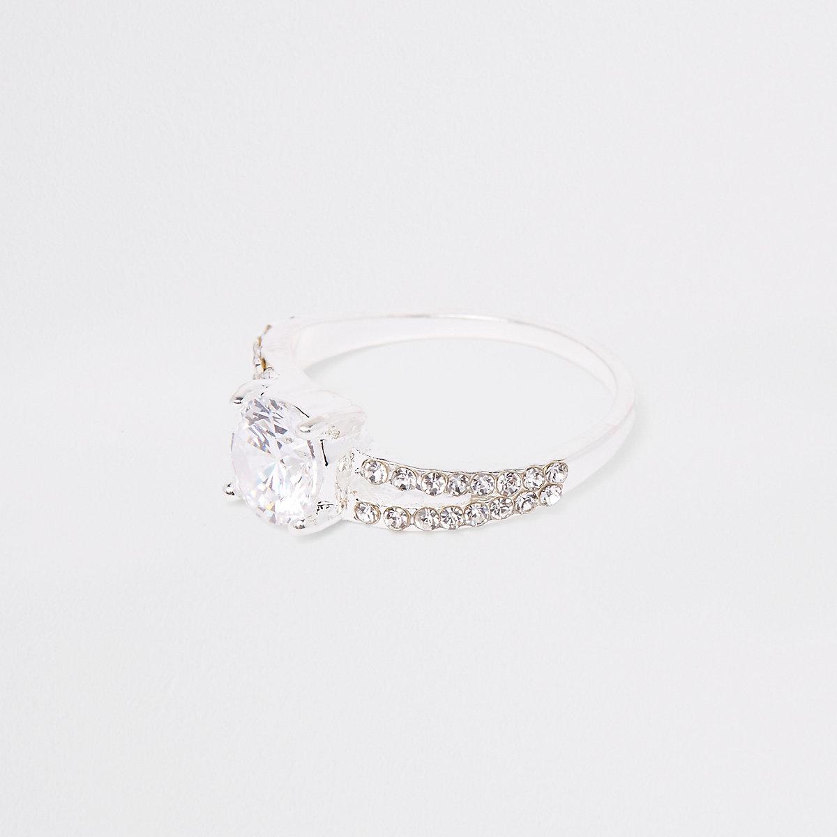 Silver tone split band rhinestone ring