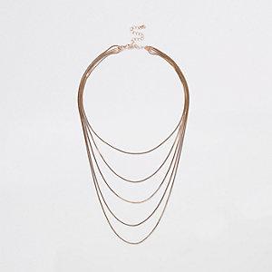 Collier doré avec chaînes superposées effet serpent