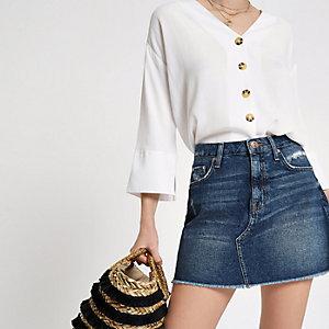 Crème blouse met knoopsluiting en lange mouwen