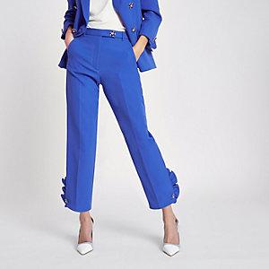 Pantalon cigarette bleu orné de fausses perles