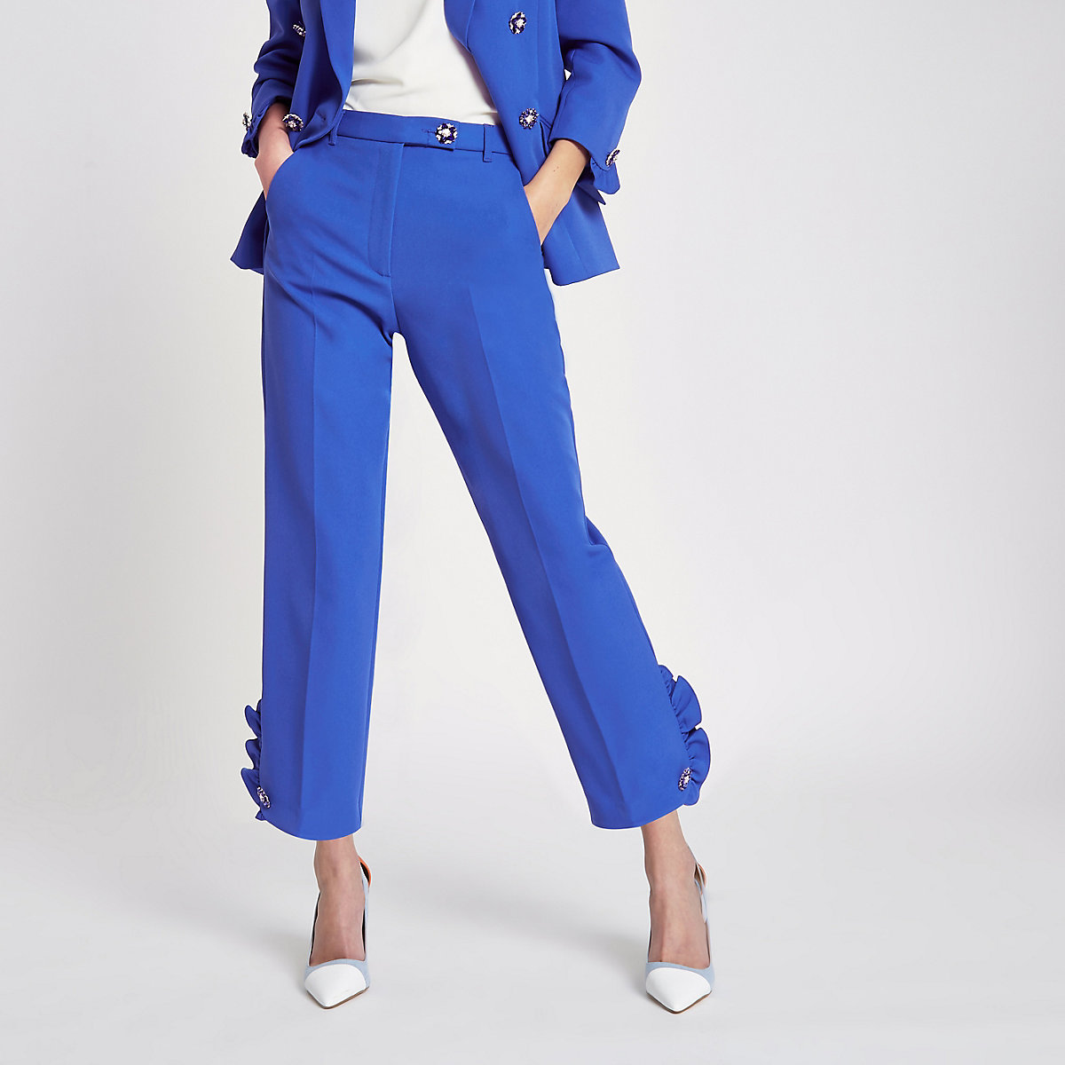 Blauwe smaltoelopende broek met imitatiepareltjes