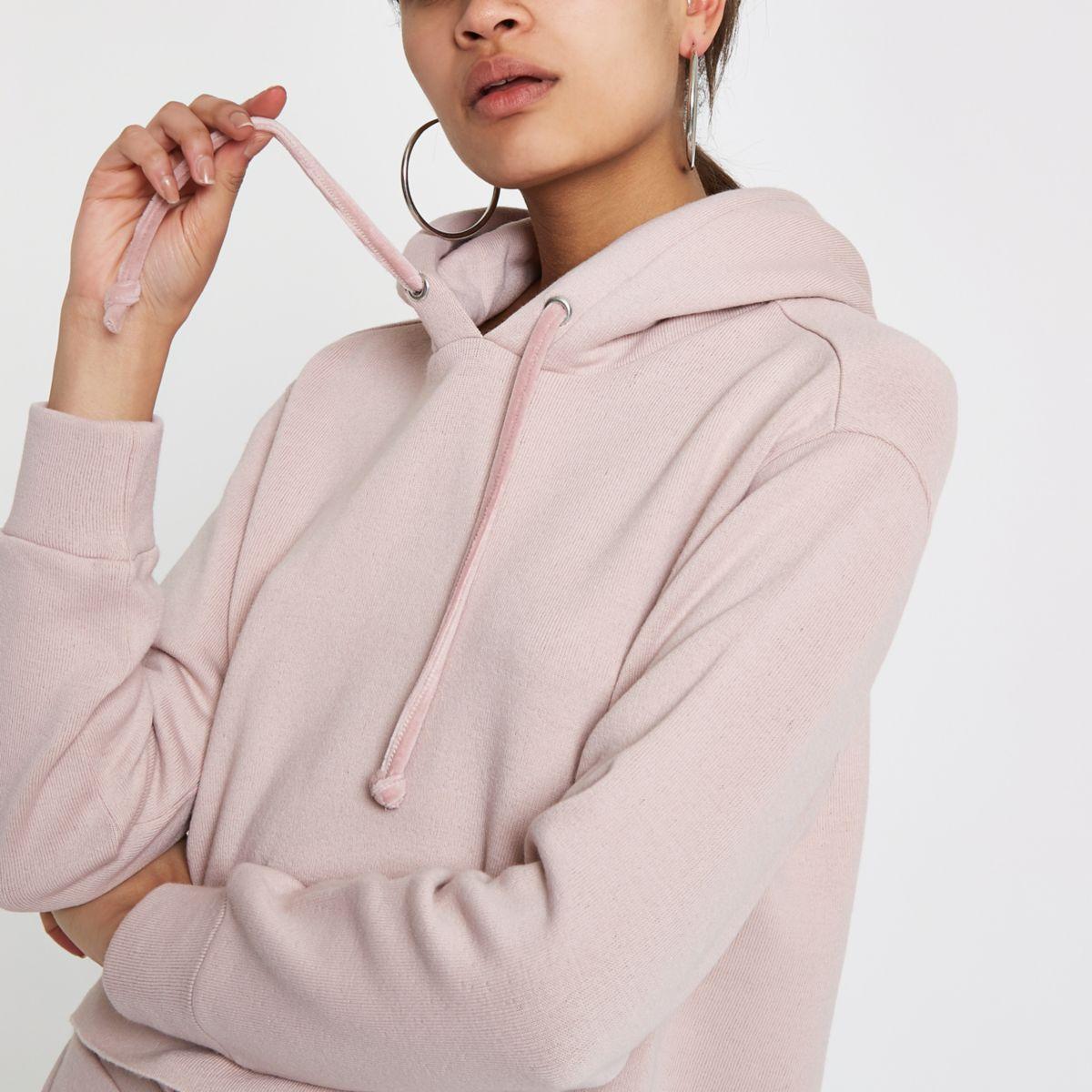 Lichtroze ruimvallende hoodie