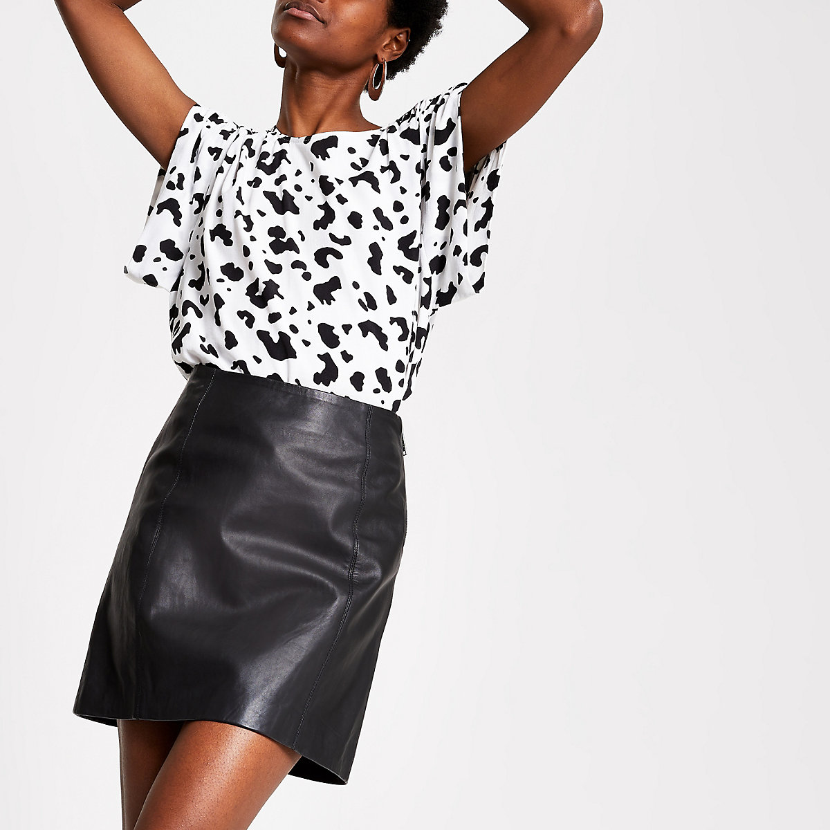 Black leather zip mini skirt