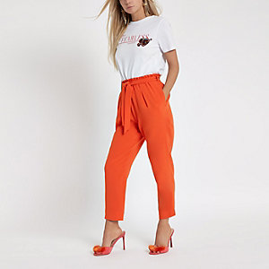 Petite orange tapered leg trousers