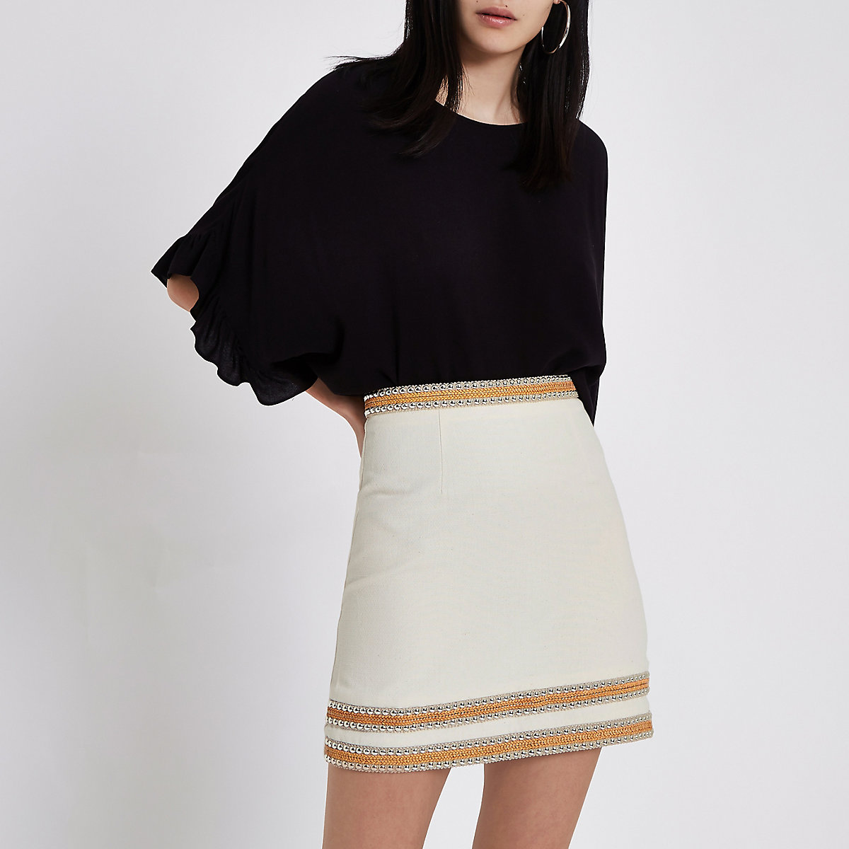 Cream silver tone trim mini skirt