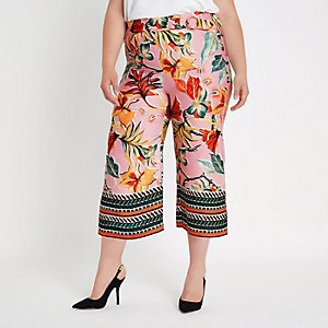 Plus pink floral mixed print trousers