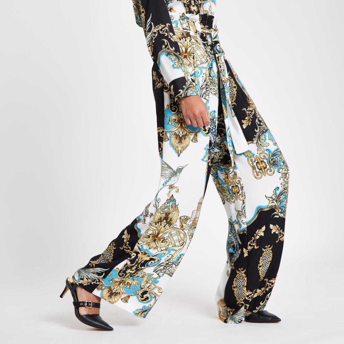 Blauwe broek met barokprint, ingesnoerde taille en wijde pijpen