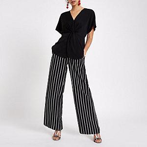 Schwarzes Satinhemd mit Knotendesign