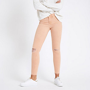 Molly - Oranje ripped jegging met halfhoge taille