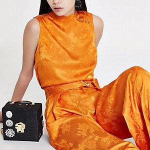 Oranje jacquard hoogsluitende top met bloemenprint
