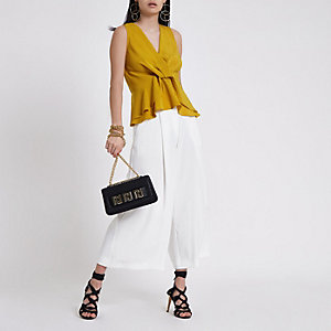 Yellow twist front frill hem top