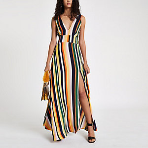 Gele gestreepte diepuitgesneden maxi-jurk met strik op de rug